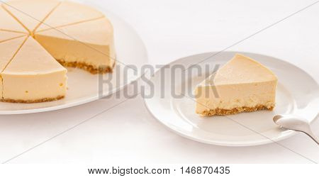 Sliced cheese cake plate with white background