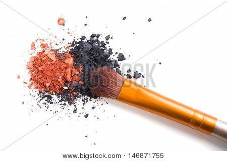 Professional makeup brush and loose powder eyeshadows isolated on white background, visage and cosmetic tools macro shot
