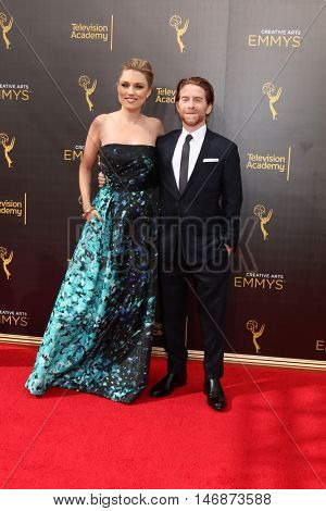 LOS ANGELES - SEP 11:  Clare Grant, Seth Green at the 2016 Primetime Creative Emmy Awards - Day 2 - Arrivals at the Microsoft Theater on September 11, 2016 in Los Angeles, CA