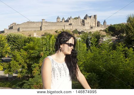 woman in front of Carcassonne city in France
