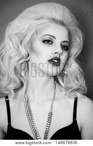 Close up portrait of beautiful blonde glam rocker woman black and white photo