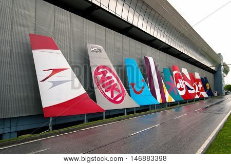 VIENNA - MAY 1 2015: Different airliners trademarks on airplane vertical stabilizers in front of Vienna airport on May 1 2015