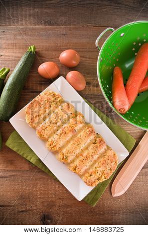 Image of vegetable meatloaf on white dish.