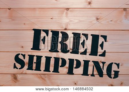Free Shipping. Free Shipping word on wooden transport box. Free Shipping Package.