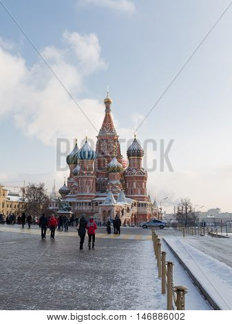 Moscow - January 7 2016: Beautiful winter urban landscape and a view of the St. Basil's Cathedral and people walk Jan. 7 2016 Moscow Russia