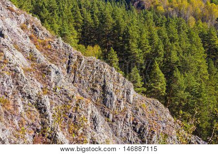 Autumn Landscape view from the heights of the mountains. Berd rocks boules Salairsky Novososedovo village district Siberia Novosibirsk region Russia