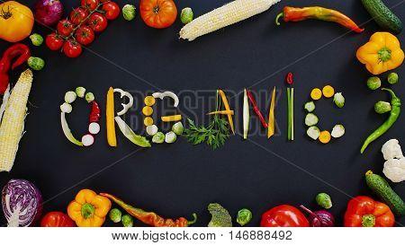 Vegetables made word organic. Vegetables made of word organic. Vegetables on a black background. Word organic on a black background.