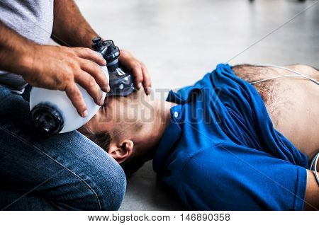 a man making CPR to an unconscious man