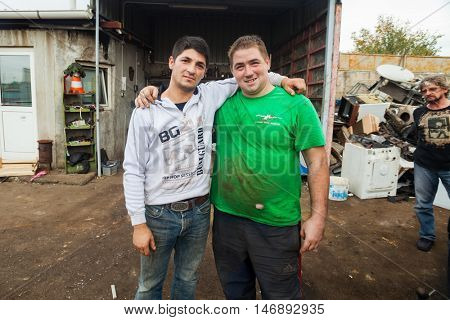 ZAGREB, CROATIA - OCTOBER 14, 2013: Roma man posing with worker at recycling yard.
