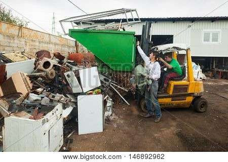 ZAGREB, CROATIA - OCTOBER 14, 2013: Roma man collecting metal waste at recycling yard.