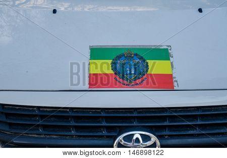 JERUSALEM ISRAEL - MARCH 30 2012: ethiopian orthodox church flag on vehicle