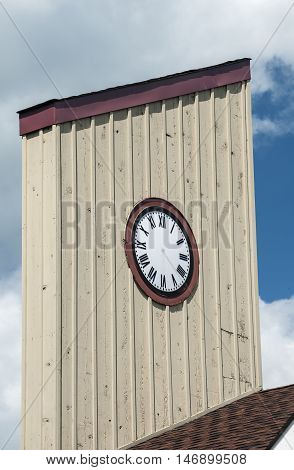 Wooden vintage tower clock with no hands