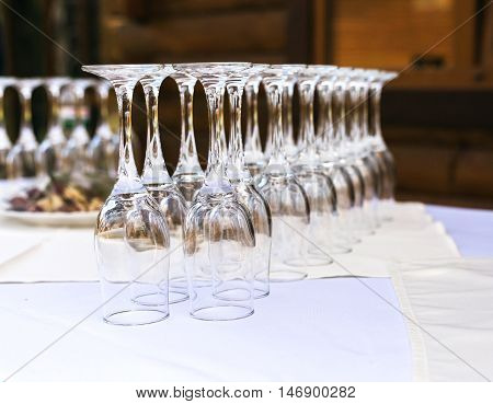 The Line Of Empty Stemware At The Table In Restaurant