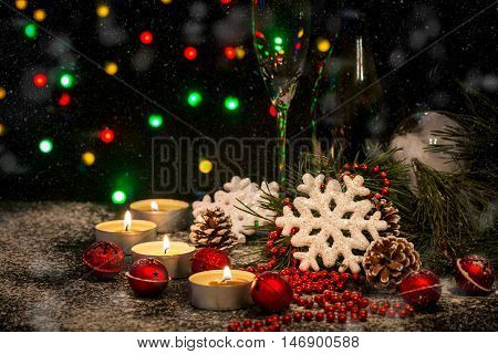 Christmas background with festive decoration, snowflakes, balls, champagne and candles. Christmas background with copyspace