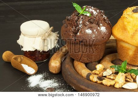 Homework muffins for breakfast. Sweet junk food. Chocolate dessert. Fresh muffins on the kitchen table. Advertising for desserts.