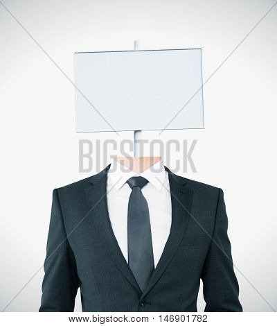 Young businessman body with white signboard instead of head on light background. Mock up