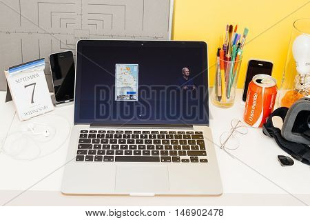 PARIS FRANCE - SEP 8 2016: Apple Computers website on MacBook Retina in room environment showcasing live coverage of Apple Keynote - Tim Cook presenting the new iPhone 7