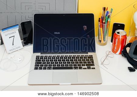 PARIS FRANCE - SEP 8 2016: Apple Computers website on MacBook Retina in room environment showcasing live coverage of Apple Keynote - Tim Cook about iWork suite eal-time collaboration for collaborative editing