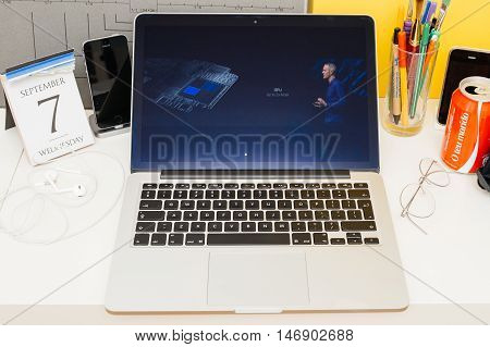 PARIS FRANCE - SEP 8 2016: Apple Computers website on MacBook Retina in room environment showcasing live coverage of Apple Keynote - gpu 2x faster on Apple Watch