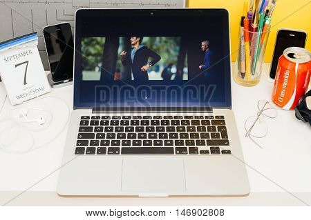 PARIS FRANCE - SEP 8 2016: Apple Computers website on MacBook Retina in room environment showcasing live coverage of Apple Keynote - Apple watch with built-in gps