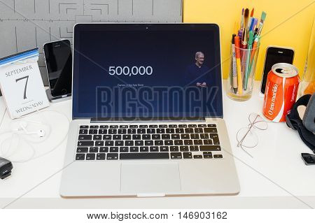 PARIS FRANCE - SEP 8 2016: Apple Computers website on MacBook Retina in room environment showcasing live coverage of Apple Keynote - Tim Cooke about more than 500 000 games in App Store