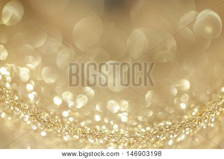 Abstract background with golden shiny glitter bokeh lights