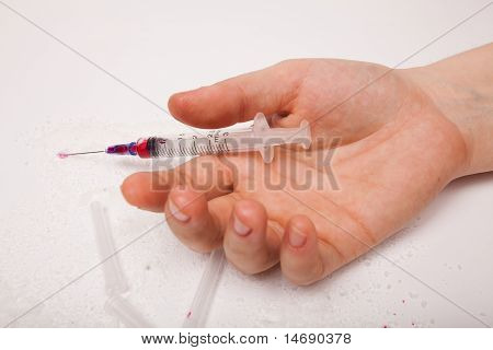 Syringe in a palm of the addict