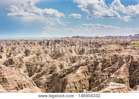 Badlands national park overlook with many canyons and clouds