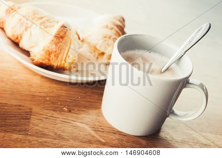 Cappuccino And Croissant. Retro Cup Of Coffee