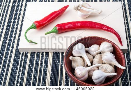 Cayenne Chillies And Garlic In A Brown Bowl
