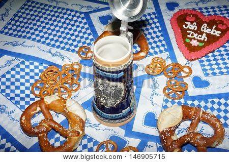 Bavarian meals for oktoberfest preparing on the bavarian national colours background