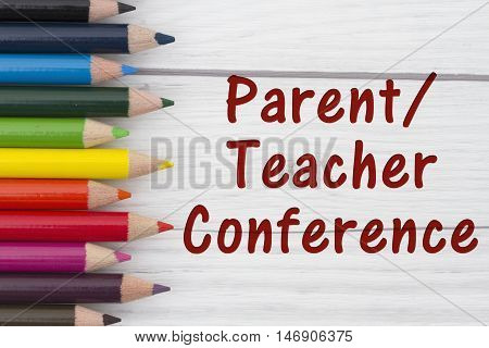Pencil Crayons with text Parent-Teacher Conference with weathered wood background