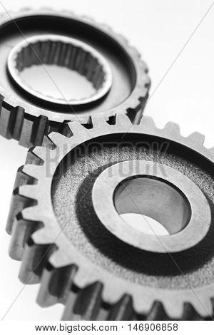 Closeup of two metal cog gears
