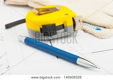 Yellow Measure Tape With Pencil And Gloves Near It