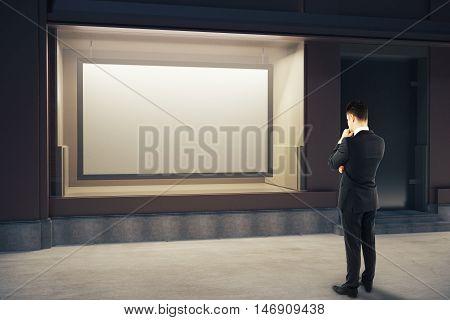 Pensive Man Looking At Billboard