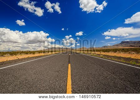 County Highway 91 Littlefield AZ 86432 USA. Endless road in the desert of Arizona.