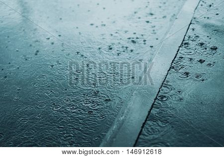 Rain, Autumn, Weather Concept - Puddle And Splashing Water In The Rainy Evening
