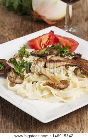 porcino mushrooms and tagliatelle on a plate