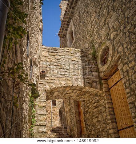 Medieval street in the city of Vezenobres, France