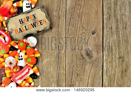 Happy Halloween Tag With Candy Side Border Against A Rustic Wood Background