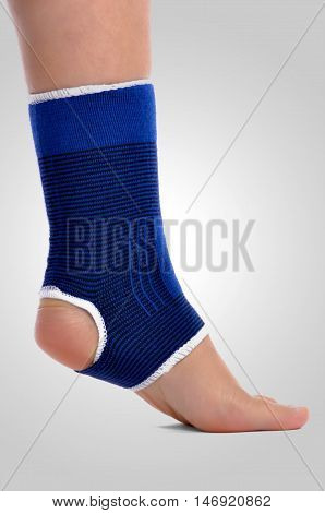 Ankle brace posing on a gradient background