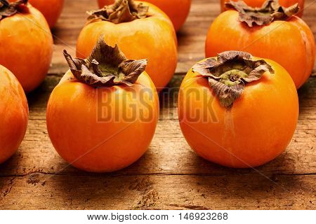 Yummy persimmon on an old wooden table