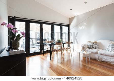 Large studio apartment living room with bi fold balcony doors