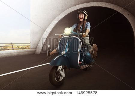 Asian Woman With Helmet Riding Scooter