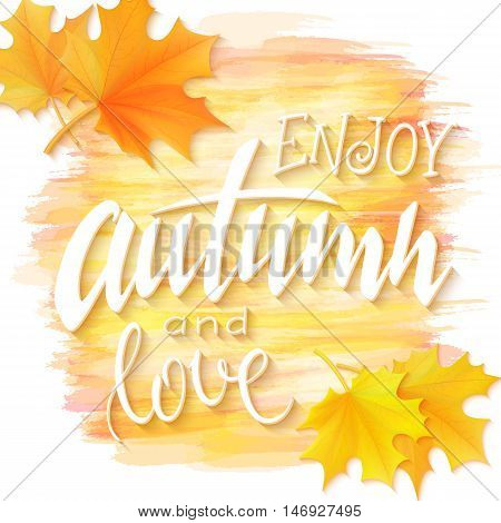 vector illustration of hand lettering phrase - enjoy autumn and love - with realistic maple leaves on watercolor imitation background.