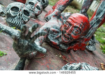 The devil sculpture in the mock up hell in the temple in Thailand.