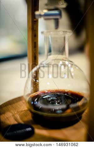 Dripping Coffee in a Glass Jar , selective focus