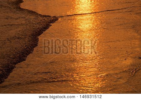 wet sand at the time of sunset