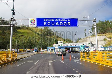 IPIALES, COLOMBIA - JULY 4, 2016: some cars driving trough the migration checkpoint in the border line between colombia and ecuador.