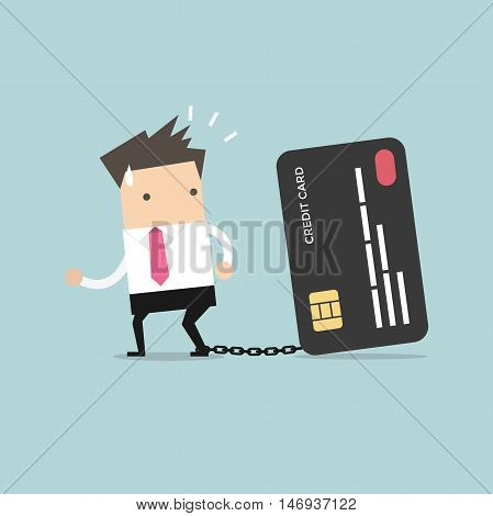 Businessman with foot chained to bank credit card trying to escape.